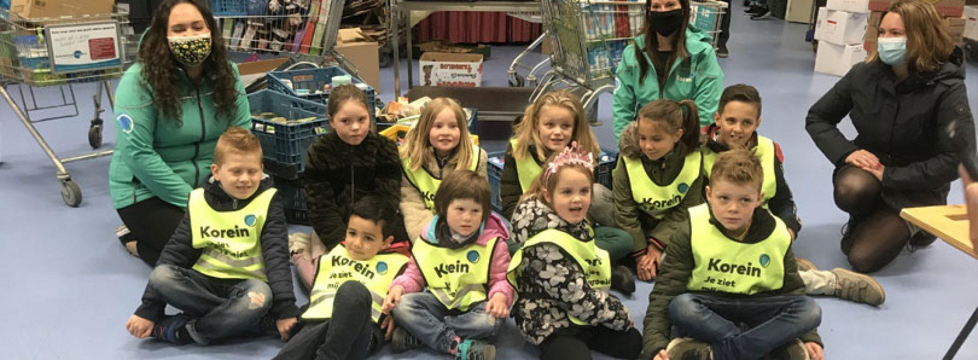 Kinderen van Korein bezoeken de voedselbank